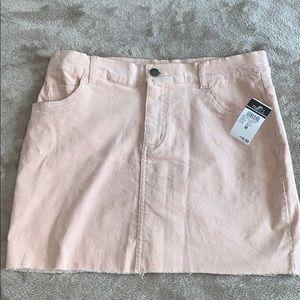 Light pink corduroy mini skirt